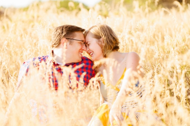 Cute couple laughing together in San Luis Obispo engagement session