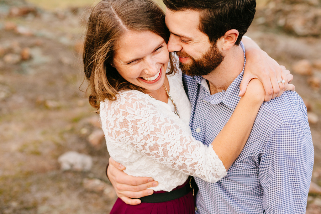 Cute couple laughing together in San Luis Obispo engagement photos