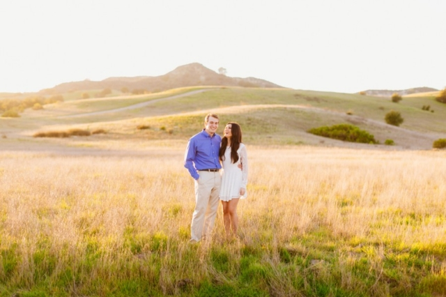 Beautiful couple laughing together in Orange County engagement photos
