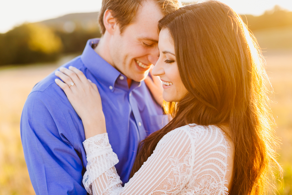 Cute couple laughing together in San Luis Obispo engagement photos at sunset