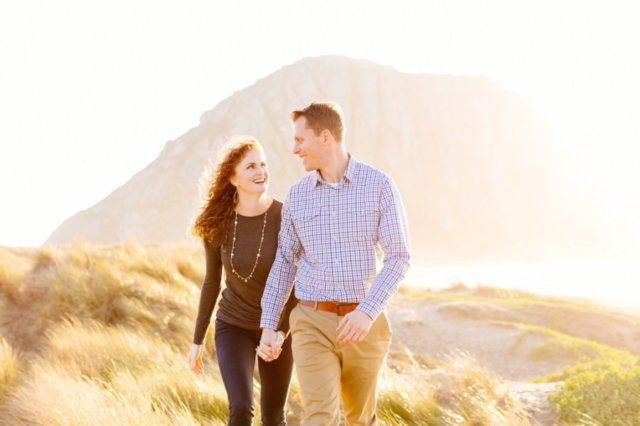Beautiful couple laughing together in Morro Bay engagement photos