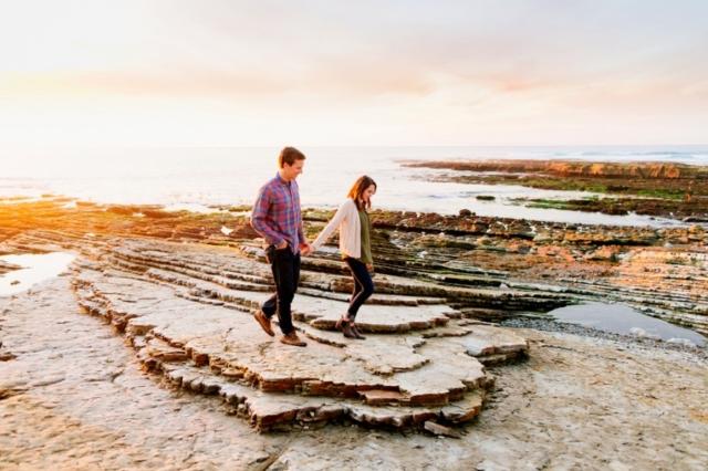 Fun couple exploring together on the beach in San Luis Obispo engagement photos