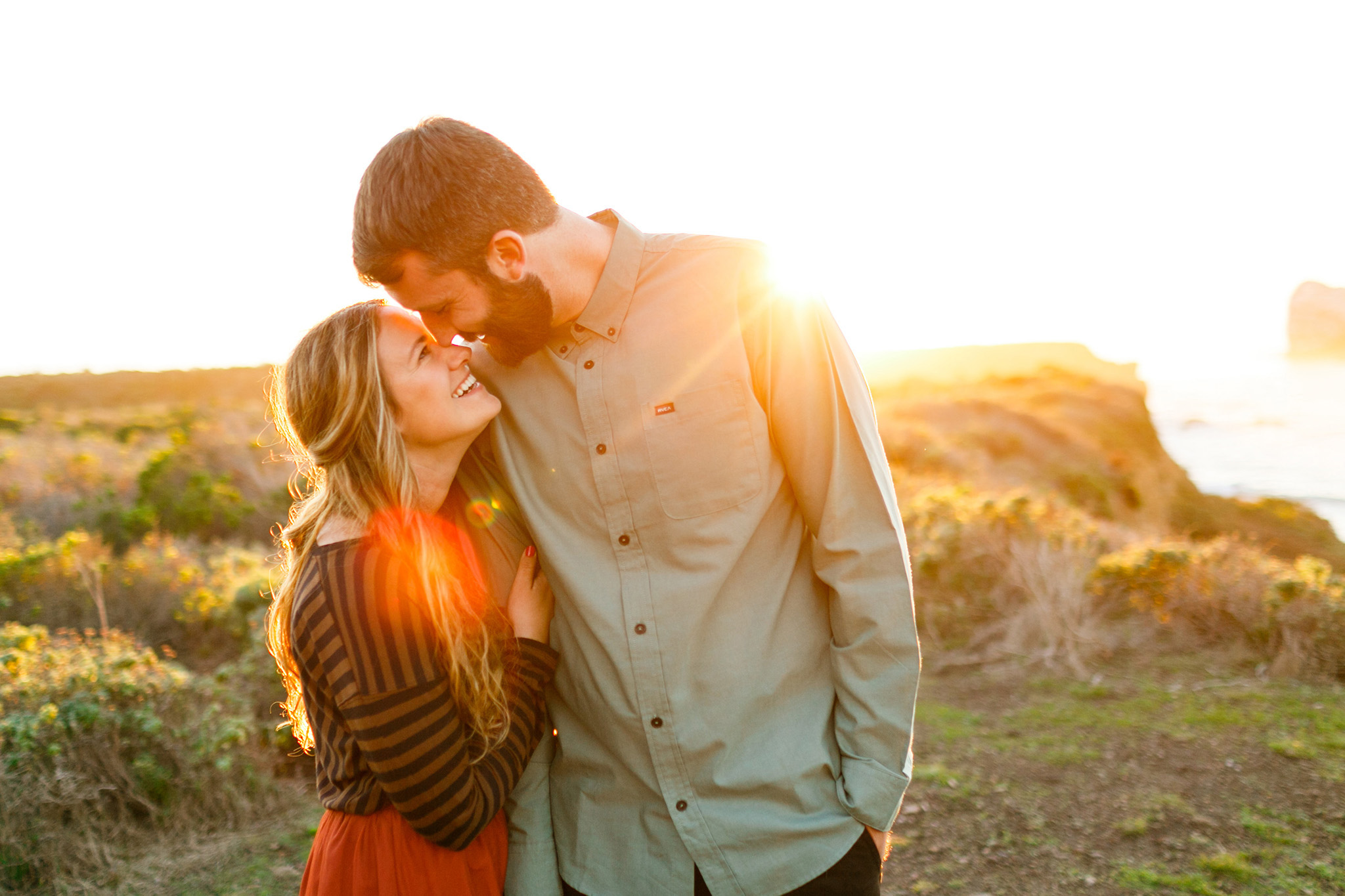 Sweet couple in the sunset a their Big Sur engagement session
