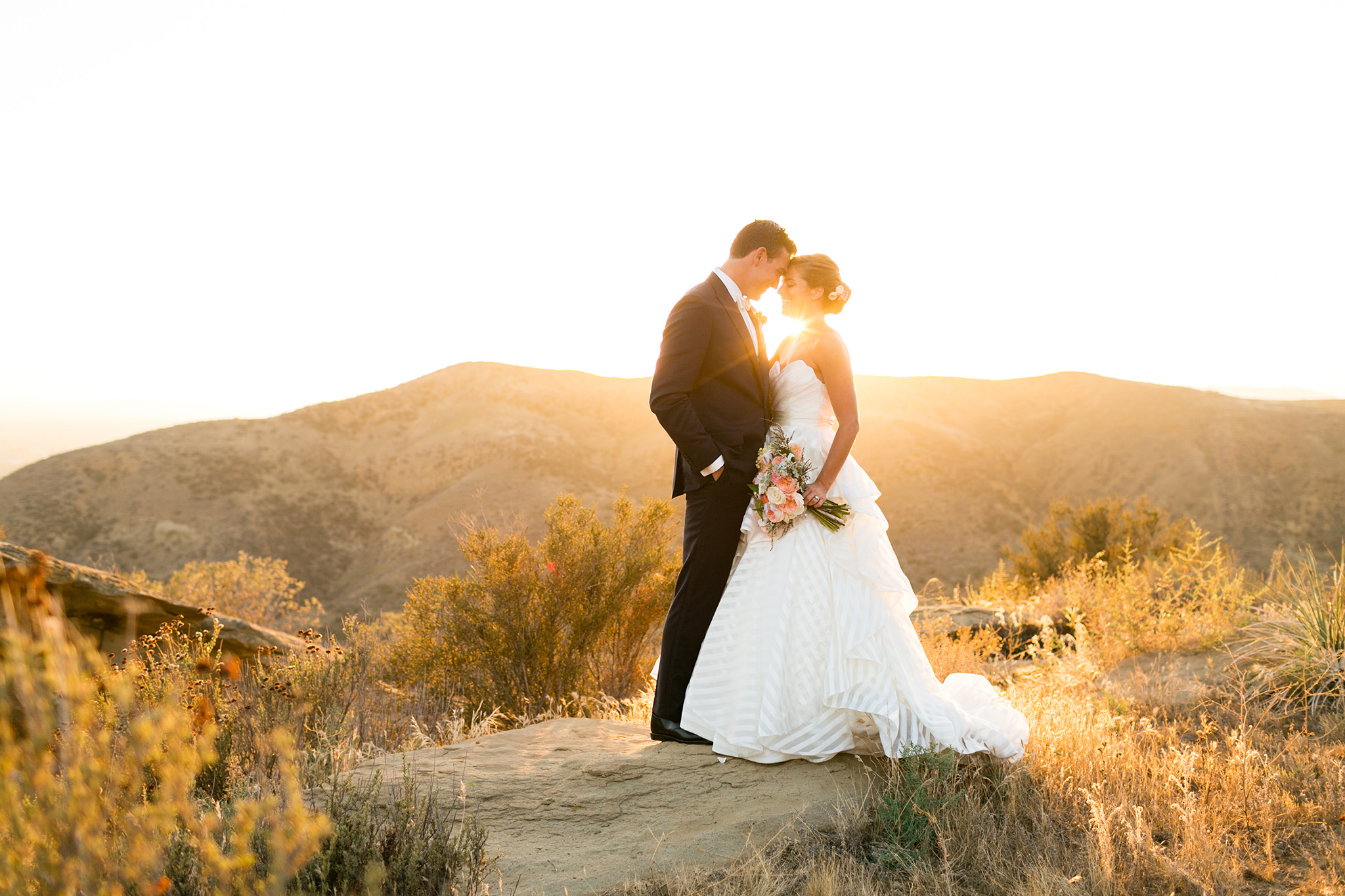 Bride and groom during sunset photos at Hummingbird Nest Ranch