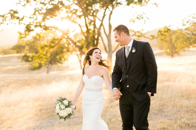 Bride and groom under the oaks at Spanish Oaks Ranch in San Luis Obispo, CA