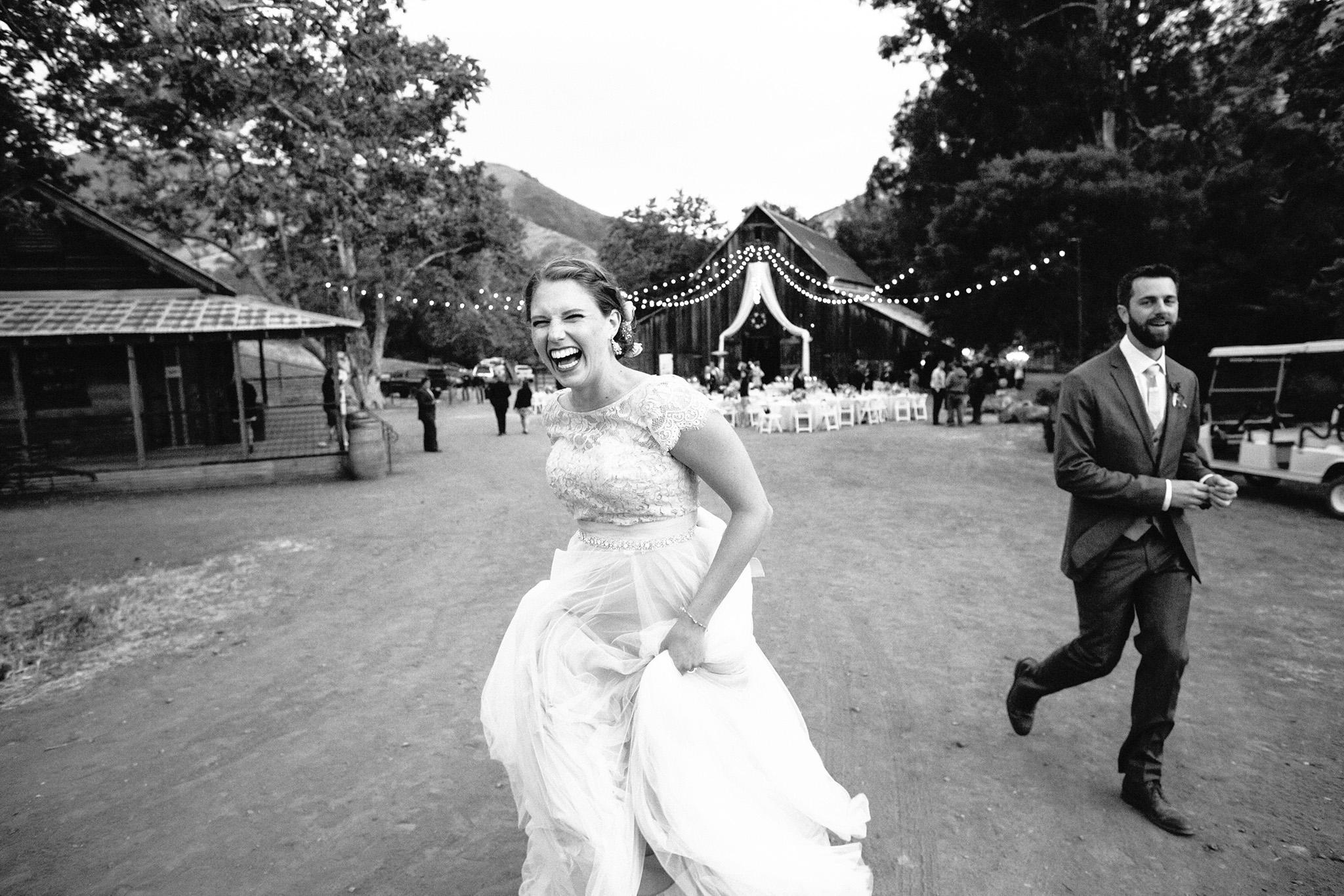 Bride and groom laughing together at their La Cuesta Ranch wedding in San Luis Obispo, CA
