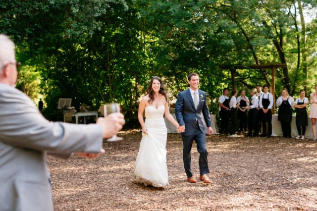 Bride and groom entering their reception at Sand Rock Farm in Santa Cruz