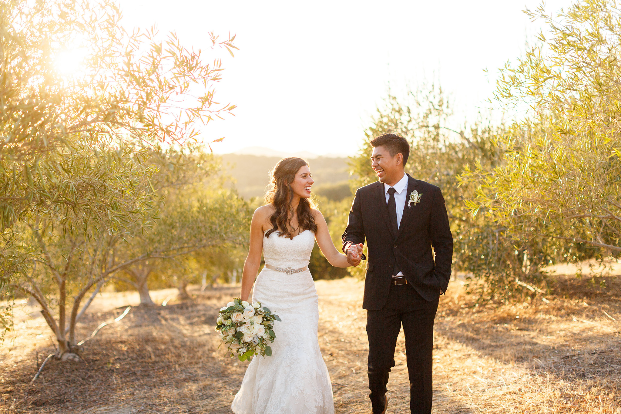 Bride and groom laughing during sunset wedding photos at Tiber Canyon Ranch wedding