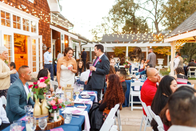 The bride and groom mingling with their guests at Spanish Oaks Ranch in San Luis Obispo