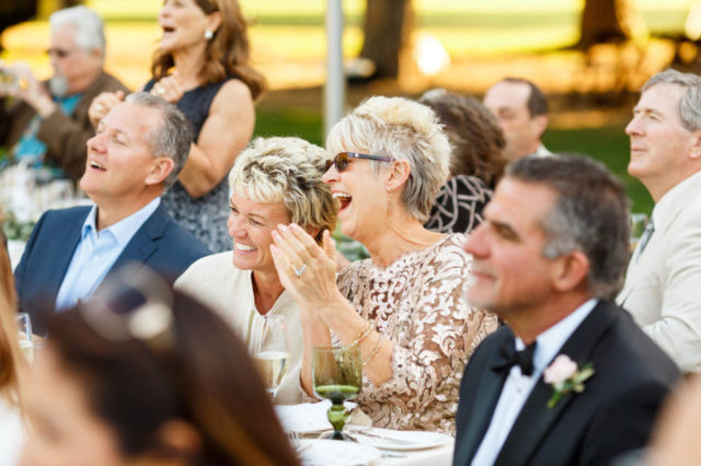 Mother of the bride laughing during toasts