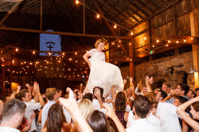 Bride lifted on the dance floor at her wedding at Santa Margarita Ranch