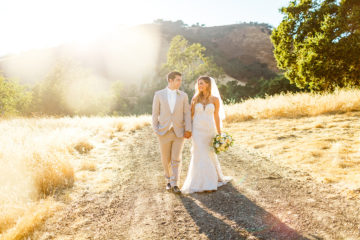 Bride and groom during sunset at Higuera Ranch wedding in San Luis Obispo